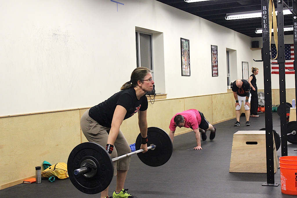 Laura hang snatches during the 0530 group WOD.
