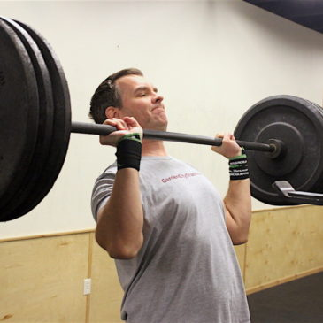 Mark push pressing during the 0530 CrossFit Missoula group WOD.