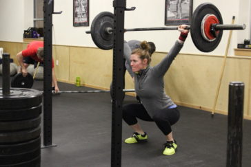 Kate overhead squatting during the 0530 CrossFit Missoula group WOD.
