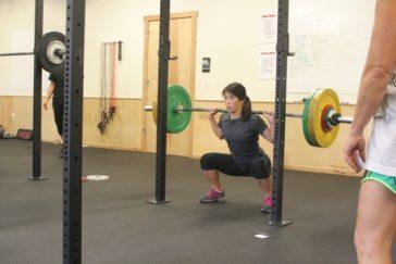 Alaina back squatting 80 kg (176 lb) during the 1700 group WOD.