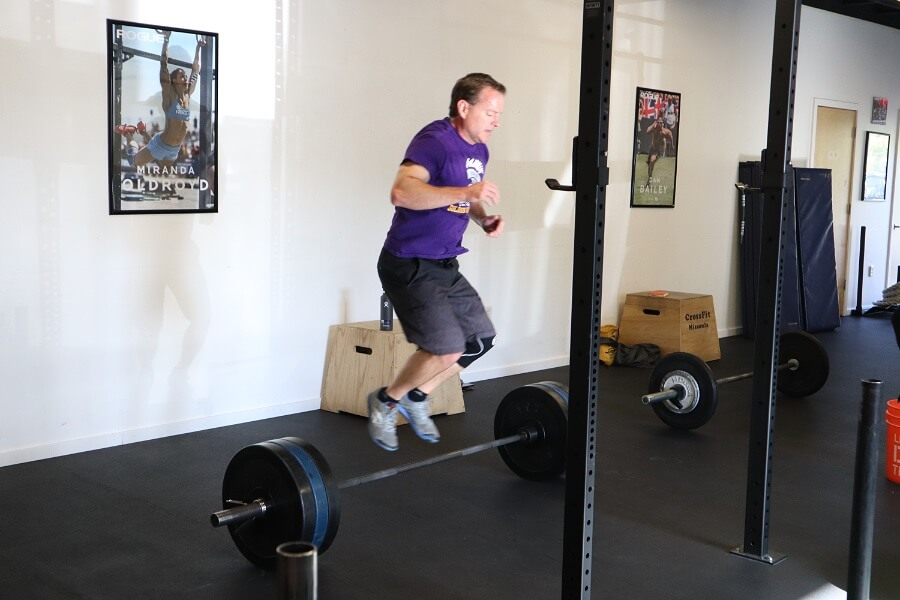 Curtis catching air over bar facing burpees
