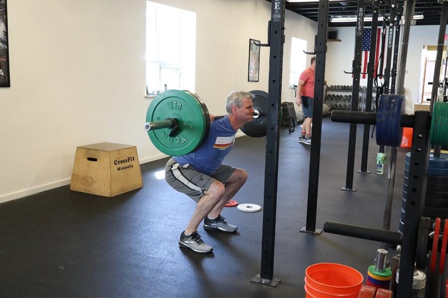 Kyle back squatting