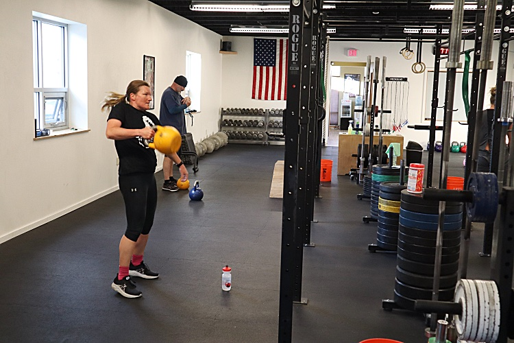 Sara pulling kettlebell cleans