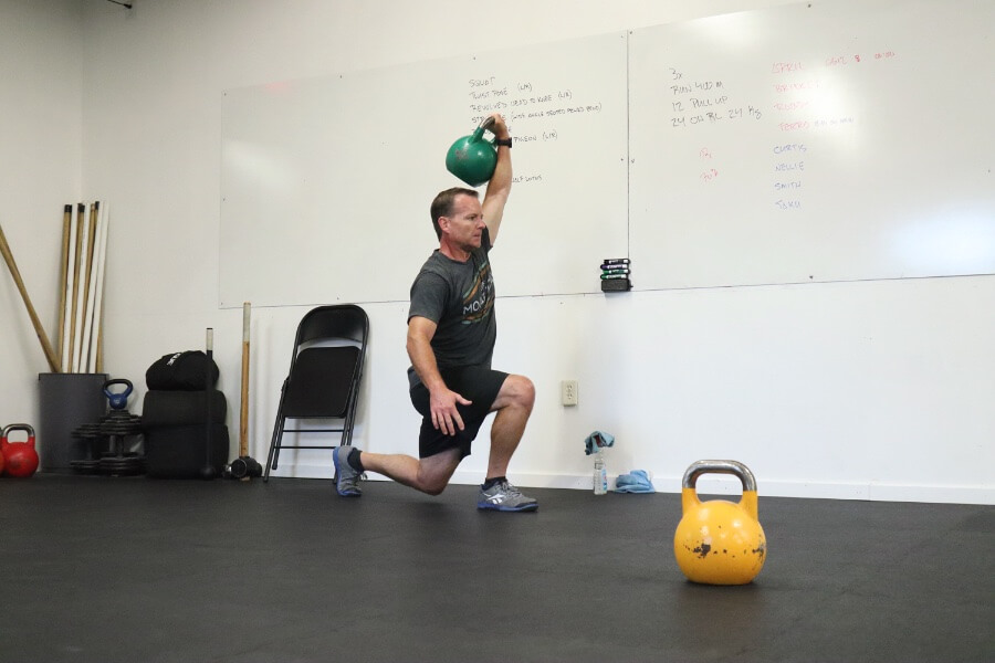 Curtis overhead kettlebell lunges