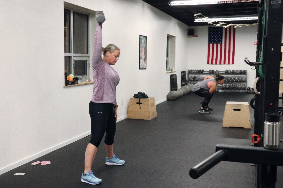 April dumbbell pressing during the 0530 hr class