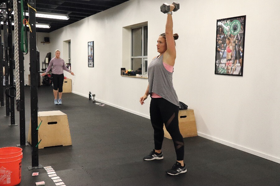 Kelly dumbbell pressing during the 0530 hr class