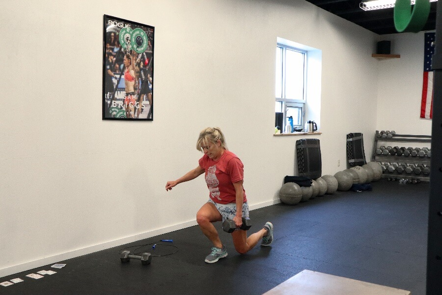 Rhonda dumbbell lunging during the 1100 hr class